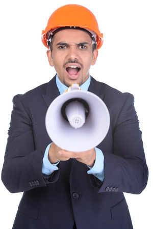 Happy young Asian engineer architect, screaming in megaphone against a white background and clipping path photo