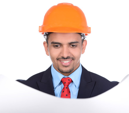 Happy young asian engineer architect read a drawing on white background photo