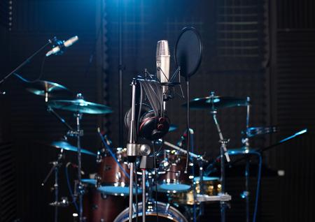 Studio room with drum set, microphones and recording equipment. Stock Photo