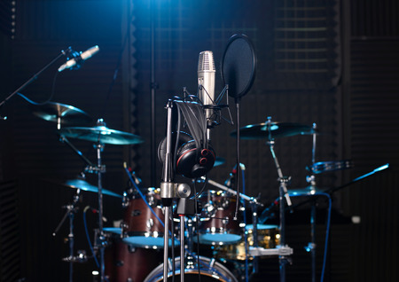 Studio room with drum set, microphones and recording equipment. photo