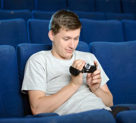 Men pirating. Young men pirating at the cinema Stock Photo