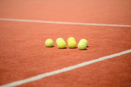 Image depicting the concept of tennis, including the court and balls photo