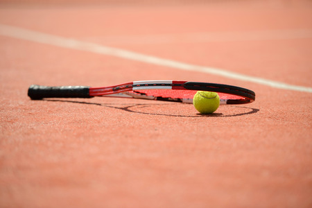 avocation: View of tennis racket and balls on the clay tennis court Stock Photo