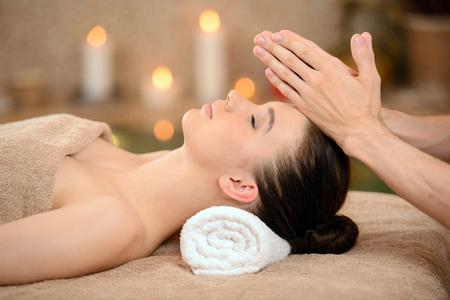 Portrait of Fresh and Beautiful brunette woman taking head massage isolated on background spa salon photo