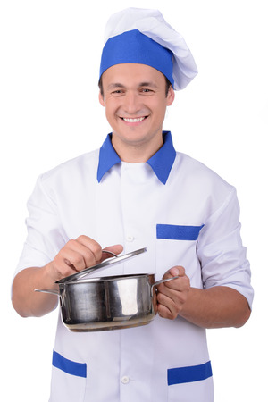 chrome man: Professional chef in white uniform and hat with metal kitchen pan isolated Stock Photo