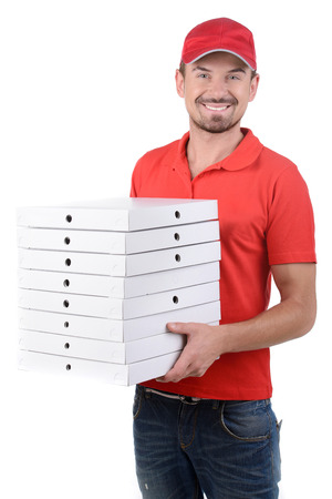 Cheerful young deliveryman holding a pizza box while isolated on white photo
