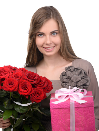 Beautiful woman smiling and holding bouquet of red roses and gift boxes, valentines day, isolated on white background photo