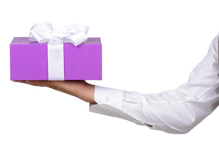 Young man holds a box with a gift, isolated on white background