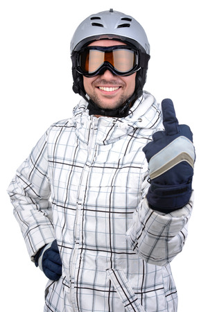 Smiling confident sportsman standing with snowboard. Wearing sport outfit isolated over white  photo