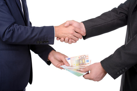 Two businessmen and paying money, isolated on white photo