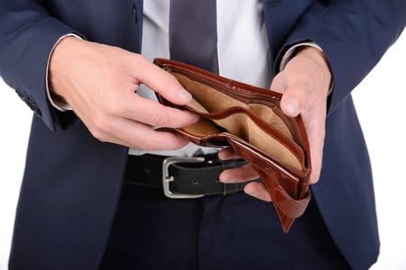 Businessman well-dressed with empty wallet, no money Stockfoto