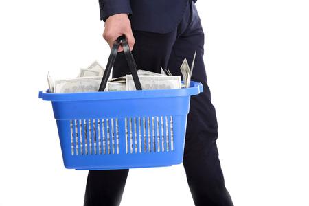 Businessman holding a shopping cart full of money isolated on white background photo