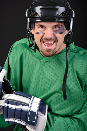 Funny hockey player smiling, bruise around the eye