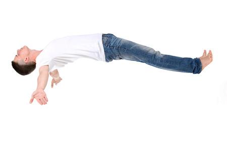 Orthopädische Matratze. Ein junger Mann schlafend auf einer Matratze, Seitenansicht. Fliegen während des Schlafens auf weißem Hintergrund Standard-Bild - 31181518