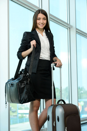 stay beautiful: Business woman on plane tickets waiting for your flight at the airport