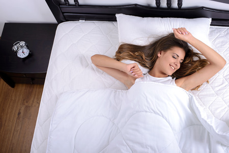 rested: Young beautiful, woman waking in the morning up fully rested. Stock Photo
