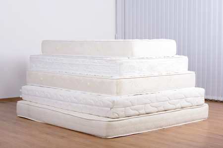 cushioned: Many mattress in a pyramid in the room