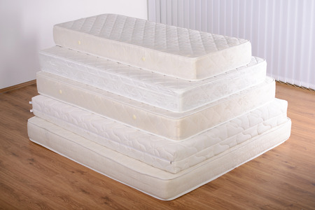 bedroom: Many mattress in a pyramid in the room