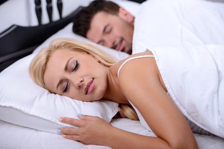 Young couple sleeping on a bed in bedroom photo