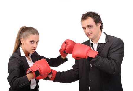 Portrait struggle businessman and business woman with bruises on her face. Battle with boxing gloves, isolated on white background photo