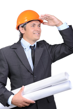 Happy young architect engineer with roll of paper on a white background photo
