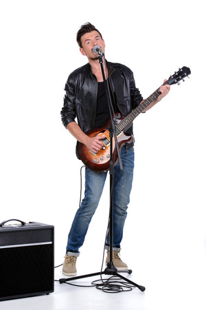 Young musician playing guitar, isolated on white Stock Photo