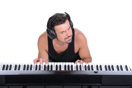 Men playing digital piano. Isolated over white background. photo