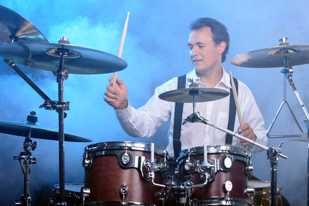 bass drum: Drummer man to play the drums. smoke background