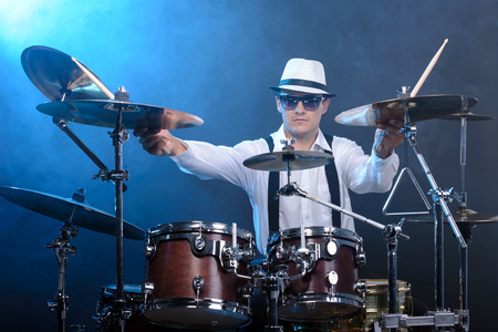 Drummer man to play the drums. smoke background photo