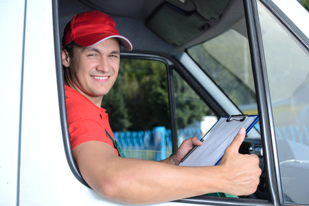 delivery truck: Postal service. Delivery of a package through a delivery service Stock Photo