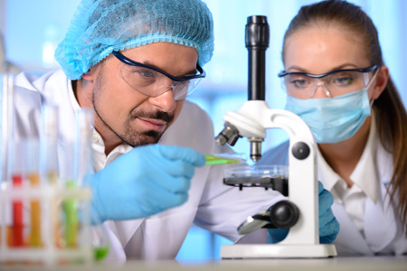 scientist: Two scientists conducting research in a lab environment Stock Photo