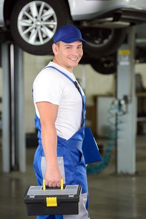 Portrait of confident male auto mechanic in workshop photo