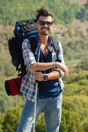 Beautiful men hiking outdoors leading a healthy lifestyle photo