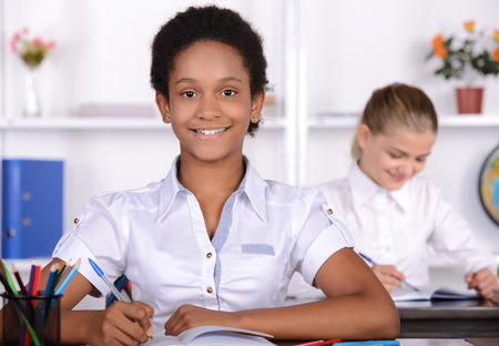 kids learning: School child with teacher in classroom during lesson. concept of school Stock Photo