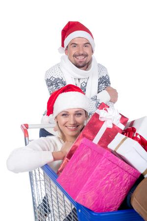 Shopping Christmas couple. Isolated on white background. photo
