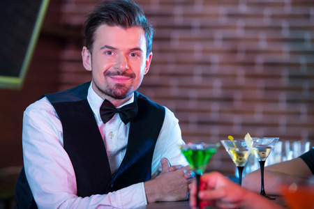 bartending: Bartender is making cocktail at bar counter Stock Photo