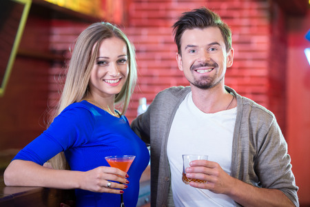drinking alcohol: Couple on a date at the bar drinking alcohol