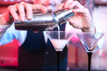 bar: Bartender is making cocktail at bar counter Stock Photo