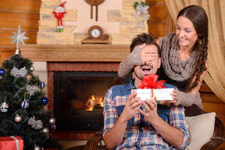 Christmas Couple. Happy Smiling Family at home celebrating. New Year People Stock Photo