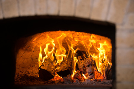 woodfire: Traditional pizza oven with stone or brick. Close-up.