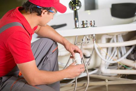 Professional plumber. Plumbing repair service. photo