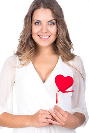 Happiness, health and love concept. Smiling woman with heart, isolated on white  photo