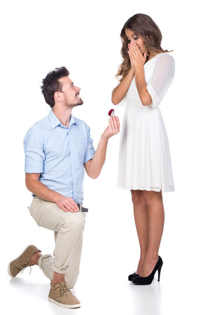Man making propose with wedding ring in gift box. isolated on white