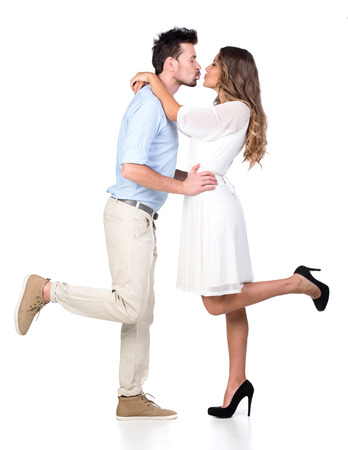 hugging couple: Beautiful couple in love kissing, isolated on white Stock Photo