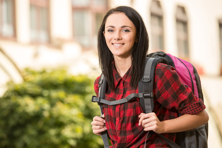 take a history: Young pretty woman, tourist with backpack, smiling. Stock Photo