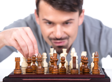 pawn adult: Portrait of a young man with a chess on a white background. Close-up.