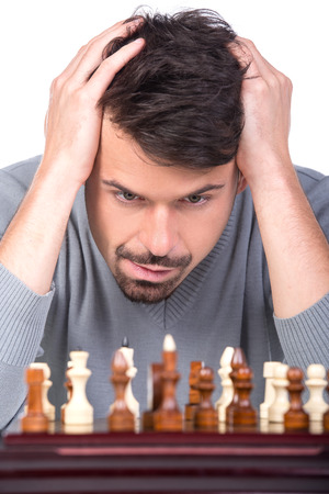 pawn adult: Portrait of a young man with a chess on a white background.