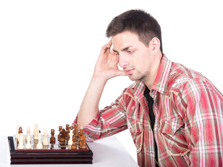 pawn adult: Portrait of a young man with chessboard is thinking to make a move.
