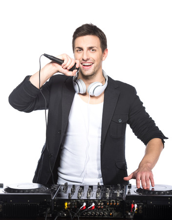 Portrait of the young male dj with dj mixer on the light background. photo