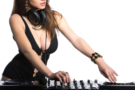 Dj woman having fun playing music on vinyl record deck. White background. photo